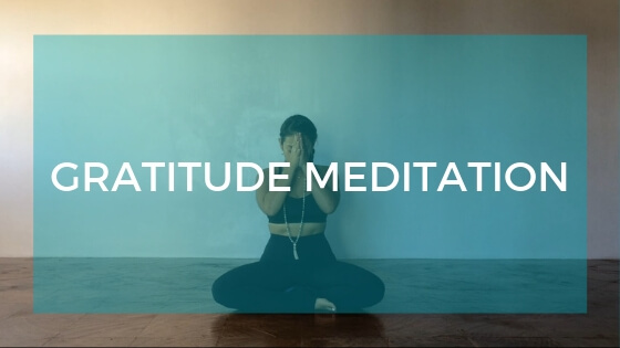 Seated meditation pose with text overlay: Gratitude Meditation