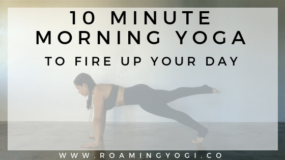Image of a young woman in a plank pose with one foot lifted off the ground, with text overlay: 10 Minute Morning Yoga to Fire Up Your Day. www.roamingyogi.co