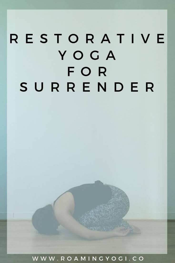 Image of a young woman in the yoga pose child's pose, with text overlay: Restorative Yoga for Surrender. www.roamingyogi.co